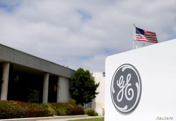 FILE - The logo of General Electric is shown at their subsidiary company GE Aviation in Santa Ana, California, April 13, 2016.