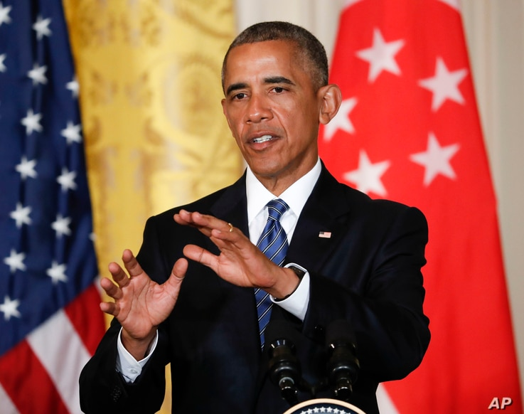 President Barack Obama answers questions during a joint news conference with Singapore's Prime Minister Lee Hsien Loong in the East Room of the White House in Washington, Aug. 2, 2016.