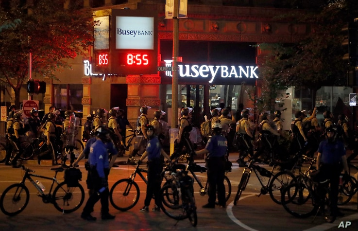Police gather as demonstrators march in response to a not guilty verdict in the trial of former St. Louis police officer Jason Stockley, Sept. 17, 2017, in St. Louis.
