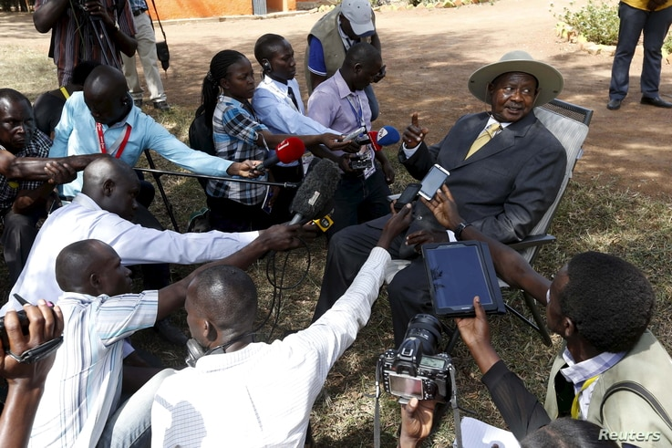 Uganda's incumbent President Yoweri Museveni speaks to the media soon after casting his vote at a polling station during the presidential elections in Kirihura, in western Uganda, Feb. 18, 2016.
