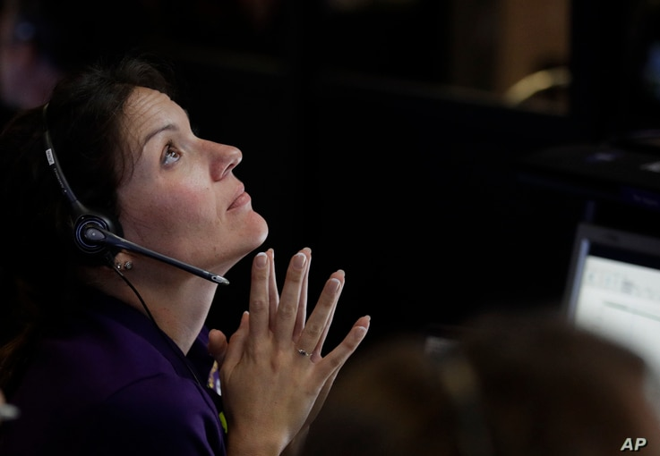 Engineer Mar Vaquero monitors the status of NASA's Cassini spacecraft as it enters the atmosphere of Saturn, in mission control at NASA's Jet Propulsion Laboratory, Sept. 15, 2017, in Pasadena, Calif.