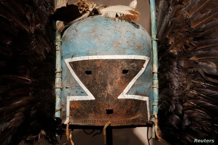 A detail of at antique tribal mask, Tumas Crow Mother, circa 1880, revered as a sacred ritual artifact by a Native American tribe in Arizona, is displayed at an auction house in Paris, April 11, 2013.