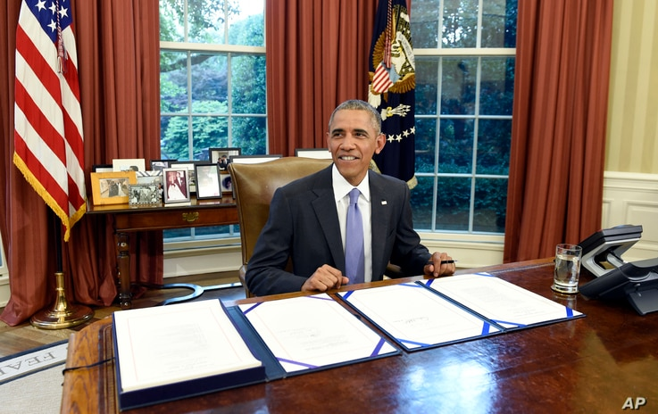 FILE - President Barack Obama smiles as he waits for the press to arrive before signing the FOIA Improvement Act of 2016 in the Oval Office of the White House in Washington, June 30, 2016.