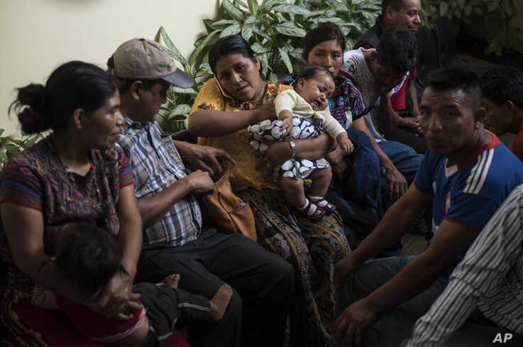 """Families wait to be reunited with their children who were separated from them by U.S. immigration authorities, at the shelter """"Nuestras Raíces"""" in Guatemala City, Tuesday, Aug. 7, 2018."""