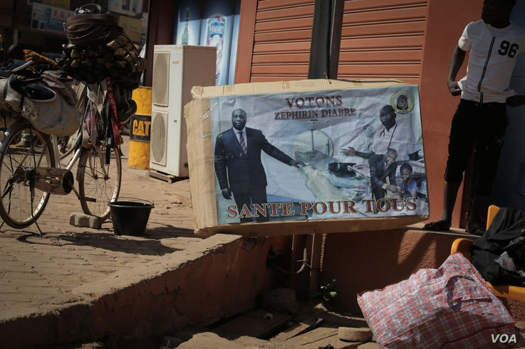 An electoral poster of candidate Zephirin Diabré is displayed on the streets of Ouagadougou, Burkina Faso.