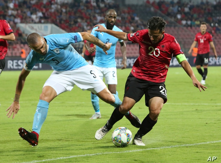 Albania's Jahmir Hyka, right,  fights for the ball with Israel's Nisso Kapiloto during the UEFA Nations League soccer match between Albania and Israel at Elbasan Arena, in Albania, Sept. 7, 2018. Albania won the match 1-0.