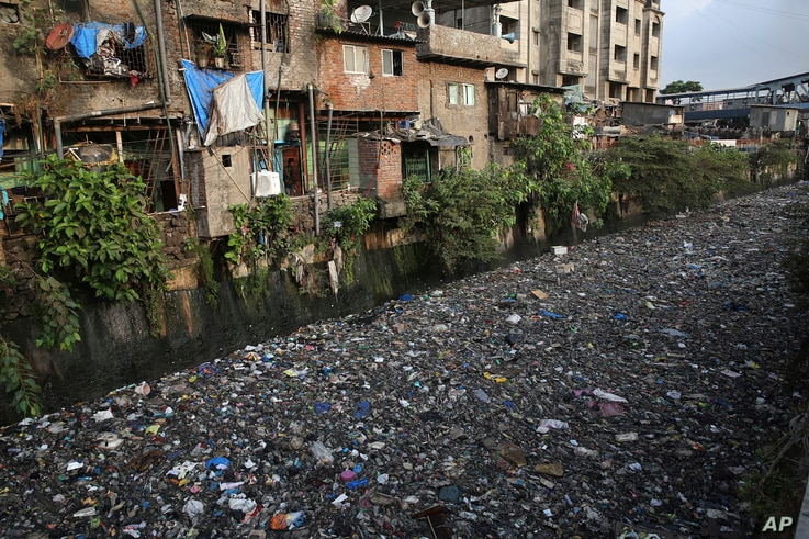 "Garbage chokes a polluted canal in Mumbai, India, Monday, June 4, 2018. The theme for this year's World Environment Day, marked on June 5, is ""Beat Plastic Pollution."""