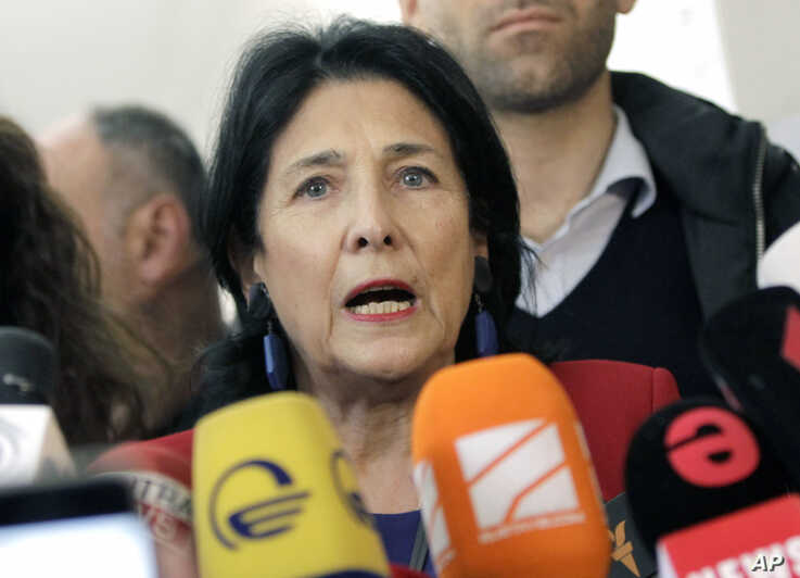 Salome Zurabishvili, former Georgian Foreign minister and presidential candidate, speaks to the media at a polling station during the presidential election at the polling station in Tbilisi, Georgia, Oct. 28, 2018.