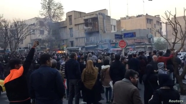 People protest in Tehran, Iran, Dec. 30, 2017, in this still image from a video.