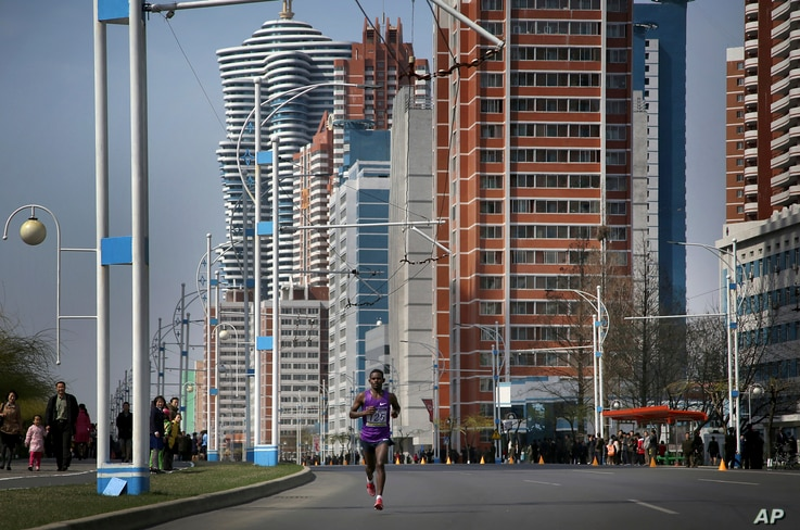 A participant of the Pyongyang marathon runs down Mirae Scientist Street, April 9, 2017, in Pyongyang, North Korea.