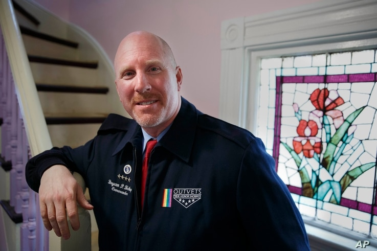 OutVets founder Bryan Bishop poses in his house in Boston, Friday, March 10, 2017.