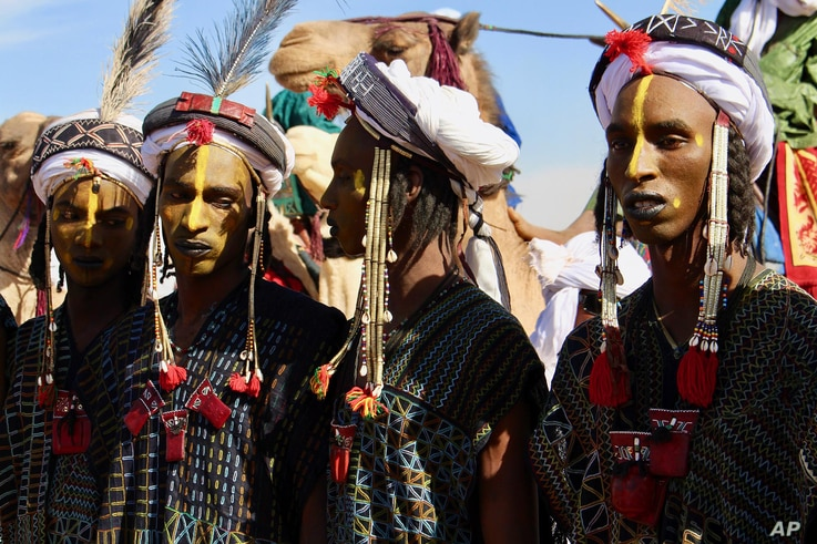 In this photo taken Feb. 17, 2018, people dress in traditional costume during a festival in Iferouane, Niger.