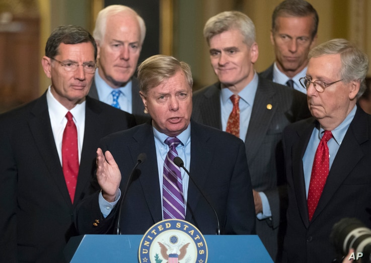 Sen. Lindsey Graham, R-S.C., joined by, from left, Sen. John Barrasso, R-Wyo., Majority Whip John Cornyn, R-Texas, Sen. Bill Cassidy, R-La., Sen. John Thune, R-S.D., and Senate Majority Leader Mitch McConnell, R-Ky., speaks to reporters as he pushes