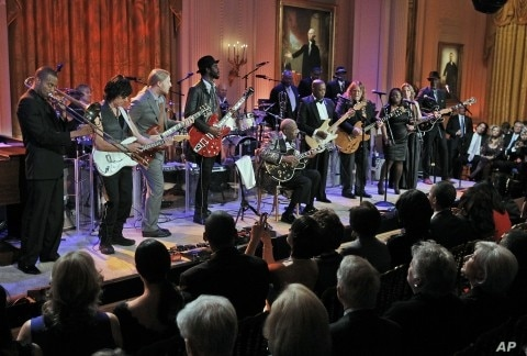President Barack Obama and first lady Michelle Obama listen to performance during the White House Music Series saluting Blues Music in recognition of Black History Month, in the East Room of the White House in Washington, February 21, 2012.