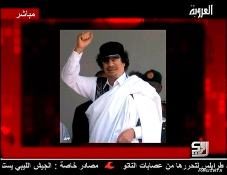A still image of Libyan leader Muammar Gaddafi is displayed to accompany his audio message broadcast by Syrian TV channel Al-Orouba, Aug. 25, 2011. The former Libyan leader was killed in October, 2011.