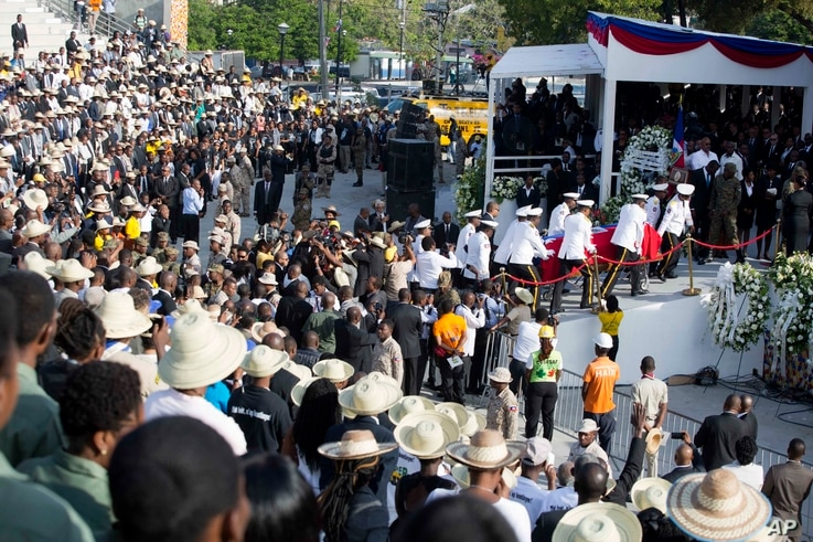 Police officers arrive with the coffin containing the remains of former President Rene Preval, at Champ de Mars plaza, in Port-au-Prince, Haiti, March 11, 2017.