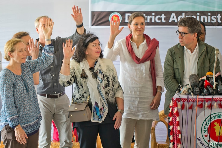 Members of the U.N. Security Council team visiting Bangladesh raise their hands during a press conference at the Kutupalong Rohingya refugee camp in Kutupalong, Bangladesh, April 29, 2018. The diplomats, were responding to a question from a journalis...