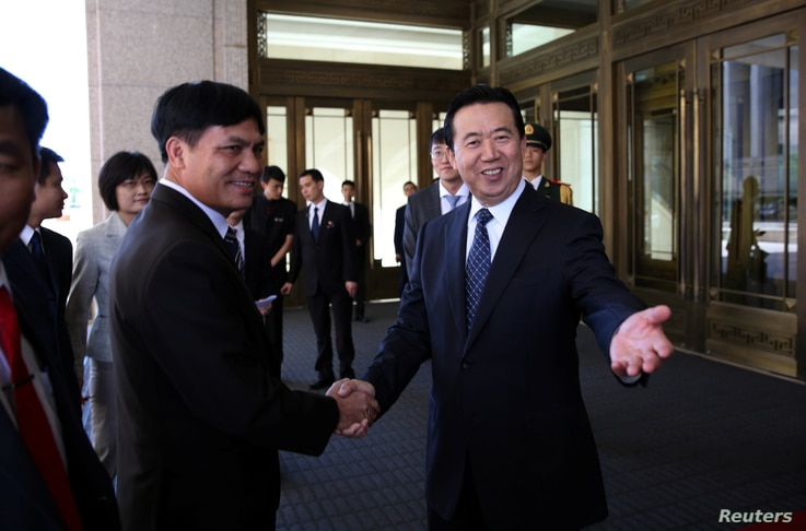 eng Hongwei (R), Chinese vice public security minister, shakes hands with Nguyen Quang Dam, the commandant of the Vietnam Coast Guard, in Beijing, China, August 26, 2016.