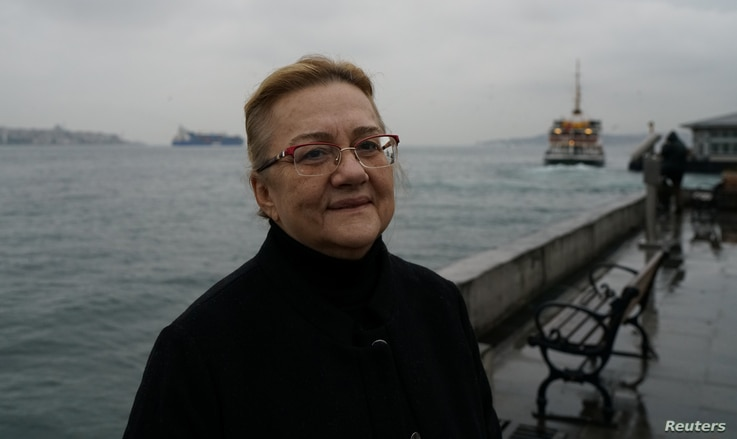 Mucella Yapici, who was called in last month by police to face more questions about her role in Turkey's Gezi Park protests, poses in Istanbul, Turkey, Dec. 17, 2018.