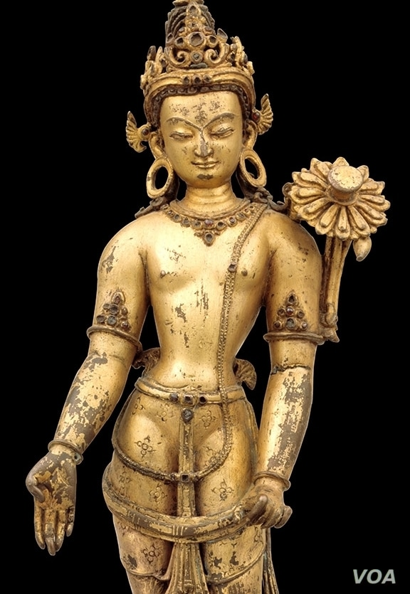 The Bodhisattva of Compassion, Avalokiteshvara, is one of the most popular deities in Nepal, where 108 forms of him are known. In his simplest form, extending his right hand in the gesture of giving and holding the stalk of a lotus (now broken) in hi...