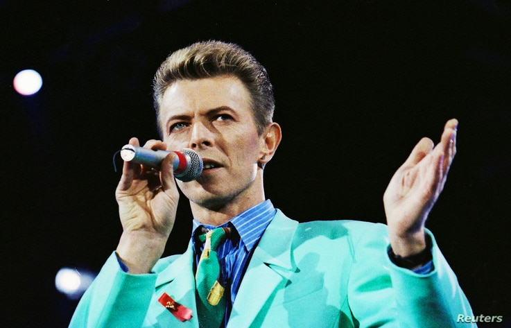 FILE - David Bowie performs on stage during The Freddie Mercury Tribute Concert at Wembley Stadium in London, Britain.