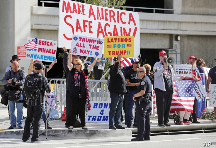 Police stand by as demonstrators who support President Donald Trump's executive orders barring entry to the U.S. by travelers from seven Muslim-majority countries rally at Los Angeles International Airport, Feb. 4, 2017.