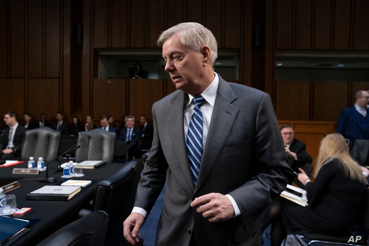 FILE - Sen. Lindsey Graham, R-S.C., is pictured on Capitol Hill in Washington, Feb. 7, 2019. Graham, who had harshly criticized President Donald Trump's decision to pull U.S. forces out of Syria, is applauding the decision to keep a small contingen...