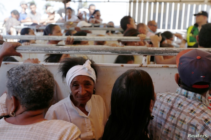 Patients wait to be attended by staff of the United States Navy hospital ship USNS Comfort outside of the Divina Pastora high school in Riohacha, Colombia, Nov. 26, 2018.