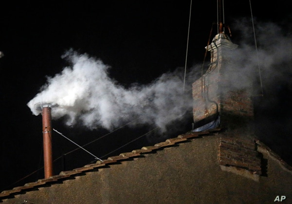 White smoke emerges from the chimney on the roof of the Sistine Chapel, in St. Peter's Square at the Vatican, March 13, 2013.