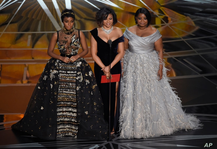 Janelle Monae, from left, Taraji P. Henson, and Octavia Spencer present the award for best documentary feature at the Oscars on  Feb. 26, 2017, at the Dolby Theatre in Los Angeles.