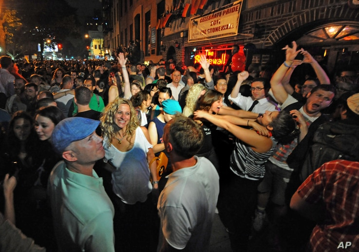 FILE - People celebrate in front of the Stonewall Inn, right, after the passing of the state's same-sex marriage bill, in New York, June 24, 2011.