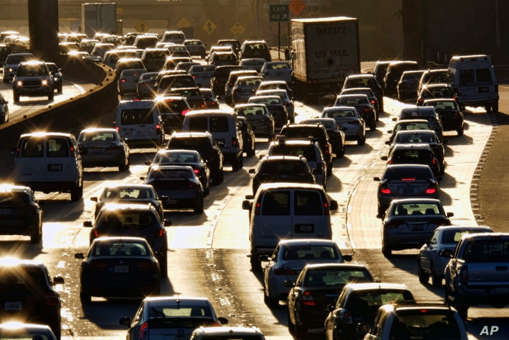 FILE - Morning rush hour traffic makes its way along US 101 near downtown Los Angeles, California, Nov. 15, 2016.