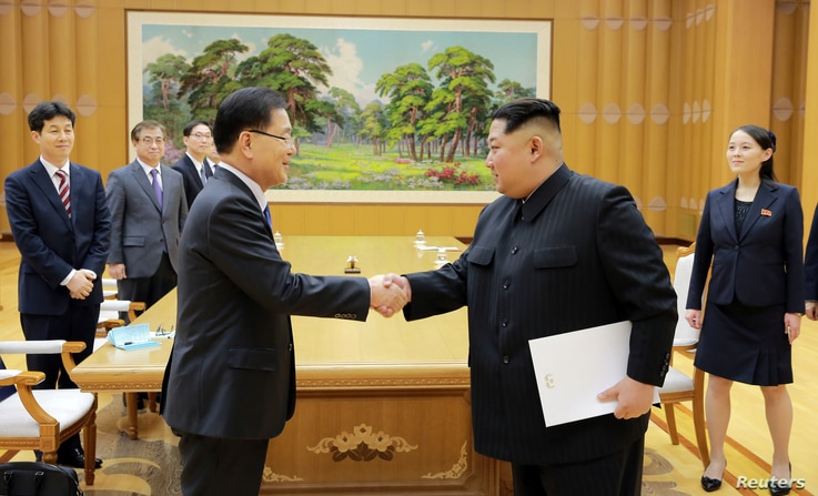 North Korean leader Kim Jong Un greets Chung Eui-yong, head of the presidential National Security Office, in Pyongyang, North Korea, March 6, 2018.