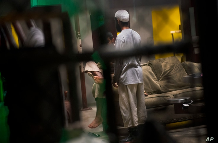 This June 6, 2018 photo, reviewed by US military officials, shows detainees inside the Camp 6 detention facility at Guantanamo Bay U.S. Naval Base, Cuba.