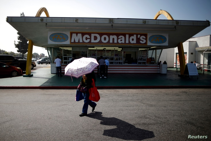 Customers visit a historic McDonald's restaurant in Downey, California, February 18, 2015.