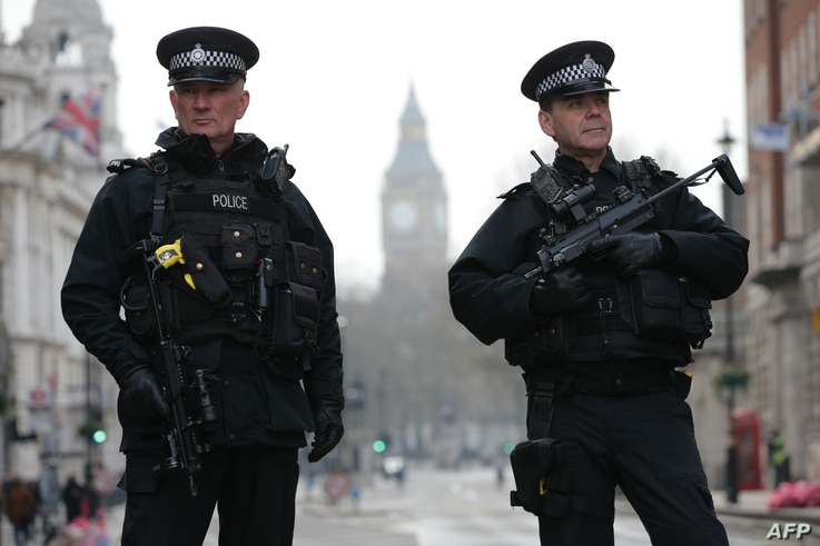 Armed police officers secure the area near the Houses of Parliament in central London on March 23, 2017 the day after the March 22 terror attack in Westminster claimed at least three lives.
