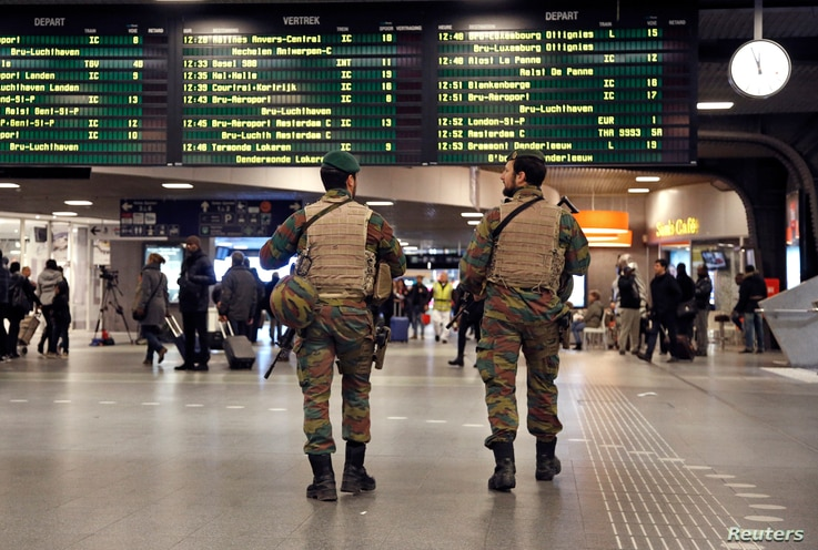 Belgian soldiers patrol in the arrival hall at Midi railway station in Brussels after security was tightened in Belgium following the fatal attacks in Paris, Nov. 21, 2015.