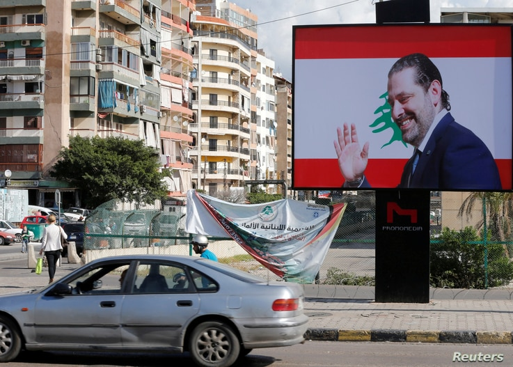 A billboard depicting Lebanon's Prime Minister Saad Hariri, who has resigned from his post, is seen in Beirut, Nov. 11, 2017.