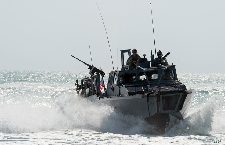 FILE - This Nov. 2, 2015, image provided by the U.S. Navy, shows Riverine Command Boat (RCB) 805 in the Persian Gulf. Iran is holding 10 U.S. Navy sailors and their two boats, similar to the one in this picture.