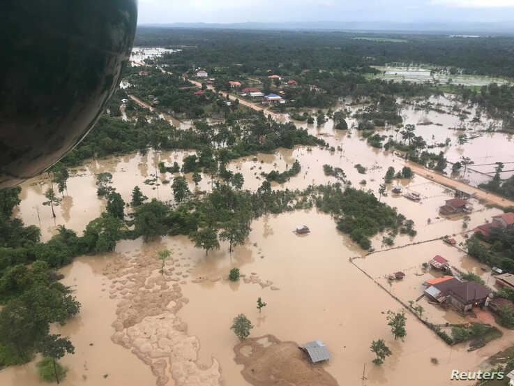 Aerial view shows the flooded area after a dam collapsed in Attapeu province, Laos, July 25, 2018, in this image from social media.