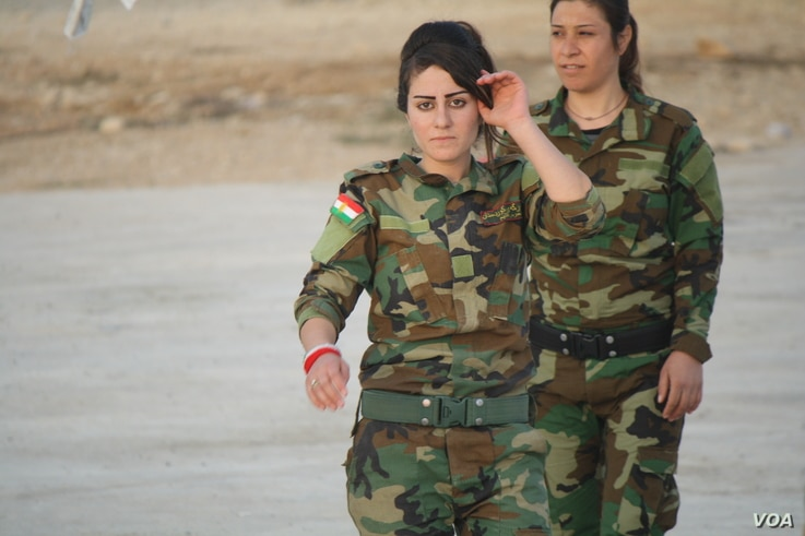 Young female fighters say they they hope to battle Islamic State militants after mass rapes, executions and kidnappings that the United Nations says amounts to genocide, Nov. 14, 2016, in Snuny, Iraq.  (H. Murdock/VOA)