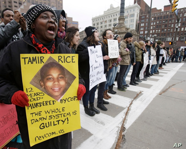 FILE - Demonstrators blocking Public Square in Cleveland during a protest over the police shooting of 12-year-old Tamir Rice, Nov. 25, 2014.