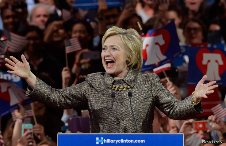 Democratic U.S. presidential candidate and former U.S. Secretary of State Hillary Clinton arrives at the podium to speak to supporters during her five state primary night rally held in Philadelphia, Pennsylvania, April 26, 2016.