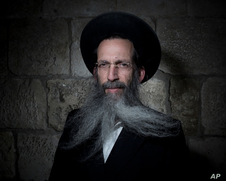 Tzvi Schiff, an Ultra-Orthodox Jew, poses for a portrait in Jerusalem's Old City, Feb. 11, 2018.