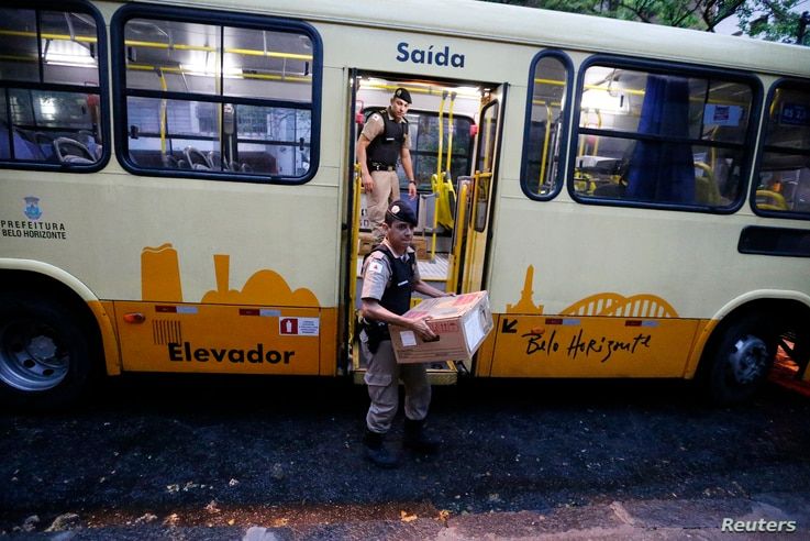 electronic ballot boxes from a bus to a voting station before polls opened in the runoff presidential election in Belo Horizonte, Oct. 26, 2014