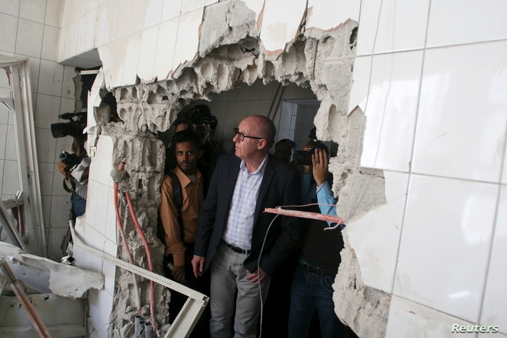 Resident Coordinator of the United Nations in Yemen, Jamie McGoldrick, inspects damage at a hospital in Yemen's southwestern city of Taiz, Jan. 21, 2016.