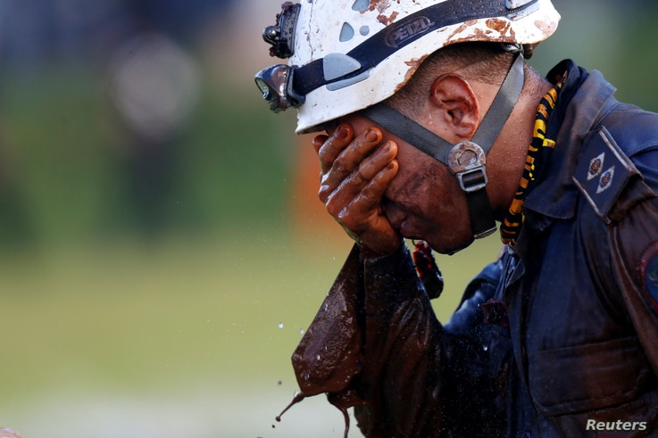 A member of rescue team reacts, upon returning from the mission, after a tailings dam owned by Brazilian mining company Vale SA collapsed, in Brumadinho, Brazil January 27, 2019.