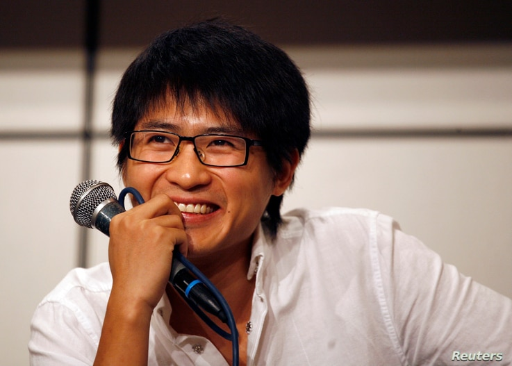 FILE - Han Han, 27, one of China's most popular bloggers based on his website's registered hits, attends a news conference during the Hong Kong Book Fair, July 22, 2010.