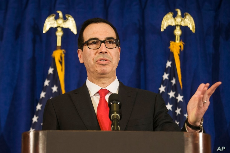 FILE - Treasury Secretary Steven Mnuchin speaks at the Hilton Midtown hotel during the United Nations General Assembly, in New York, Sept. 21, 2017.