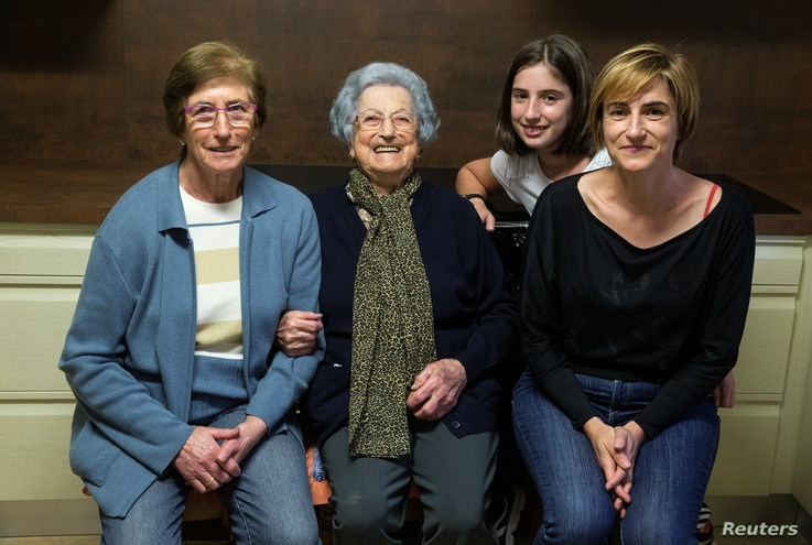 Second from left, Pilar Fernandez, 101, poses with her daughter Pili (L), granddaughter Flori (R) and her great granddaughter Ana in Ambas, Asturias, northern Spain, Oct. 18, 2016.